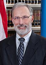 Judge J. Travis Laster