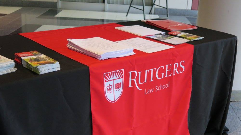 Table with Rutgers Law School logo and orientation materials