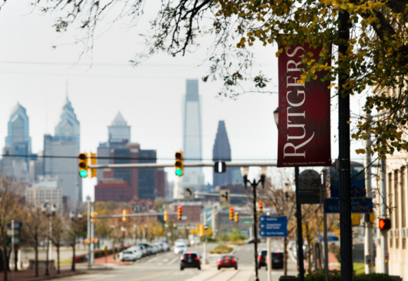 Rutgers banner in front of the Philadelphia skyline