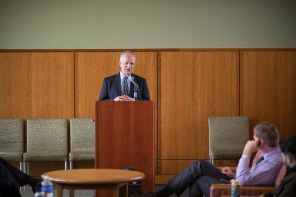 Professor addressing other professors.