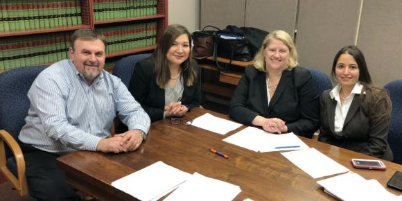 Professor Meredith Schalick (third from left) with South Jersey Legal Services' Richard Chiumento, Kristine Gurski, Michelle Nuciglio