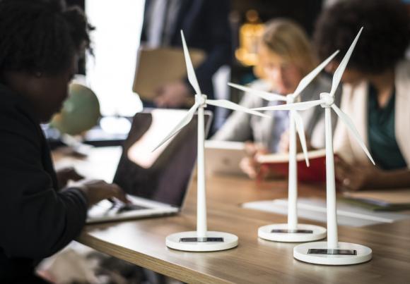 Model wind turbines sit on an environmental lawyer's desk.