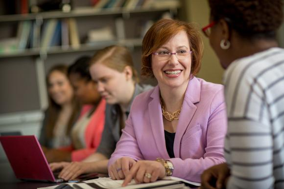Professor Ruth Anne Robbins with students in Camden