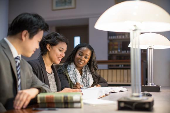 Three students sitting in the library