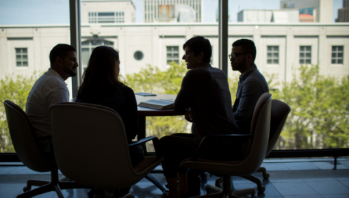 Silhouettes at a conference table