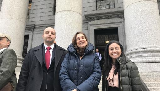 Zeyad Assaf stands with Professor Venetis and another female student on the Essex county Courthouse steps