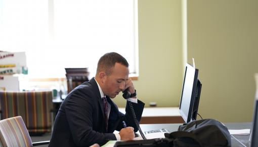 Chris Campise on the phone at the clinic offices