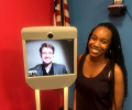 Morgan Humphrey at the ACLU photographed with Edward Snowden on a telepresence robot.