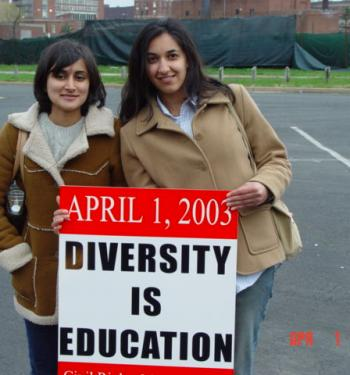 students with sign promoting diversity